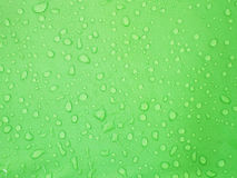 Water drops on green waterproof fabric Royalty Free Stock Images