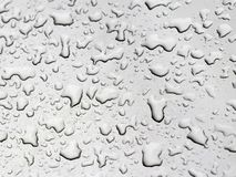 Water drops on a grey car stock images