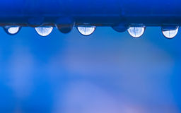 The water drops on the horizontal bar Stock Photo