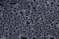 Water drops on hydrophobic plastic surface Stock Images
