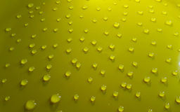 Water drops. On a light yellow background Stock Image