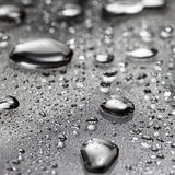 Water drops/liquid metal Stock Images