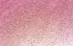 Water drops on metal surface with blur effect. Abstract color background and texture for design Stock Photos