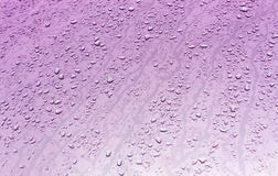 Water drops on metal surface with blur effect. Abstract color background and texture for design Stock Photography