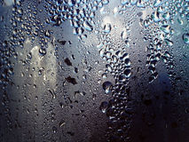 Water drops on metal surface. Close up of Water drops on metal surface Stock Image