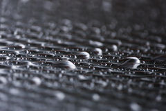 Water drops on metal surface. Texture Stock Photography