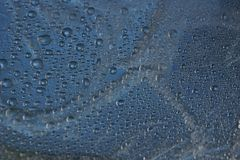 Water drops on metal surface texture background. Shiny metal surface Royalty Free Stock Photo
