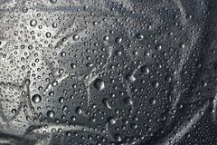 Water drops on metal surface texture background. Shiny metal surface Stock Image