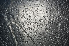 Water drops on metal surface texture background. Shiny metal surface Stock Images