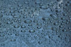 Water drops on metal surface texture background. Shiny metal surface Royalty Free Stock Photos