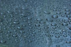 Water drops on metal surface texture background. Shiny metal surface Stock Photo