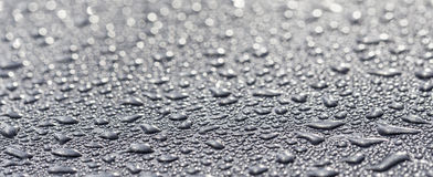 Water drops on a metallic surface Stock Photo