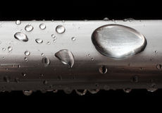 Water drops on misted metal tube Royalty Free Stock Images