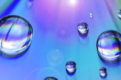 Water drops on multicolor background Royalty Free Stock Photo