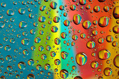 Water drops on multicolor background Stock Photo