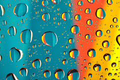 Water drops on multicolor background Royalty Free Stock Photos