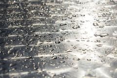 Water Drops On A Shiny Metal Surface. Background.