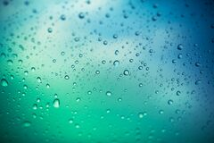 Free Water Drops On Glass Window, Green And Blue Background Royalty Free Stock Image - 186729746