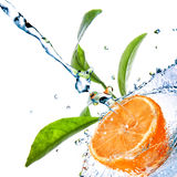 Water Drops On Orange With Green Leaves Royalty Free Stock Image