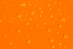 Water drops on orange metal ba Stock Images