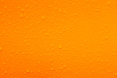 Water drops on orange texture Stock Images