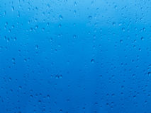 Water drops over blue Stock Photography