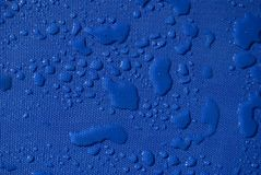 Water Drops Pattern on Blue Textile stock images