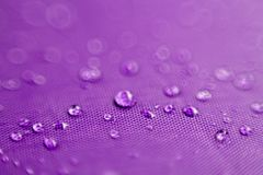 Water drops on purple backgrounds. Close-up of water drops on purple backgrounds stock photos