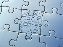 Water drops. On a puzzle piece Royalty Free Stock Images