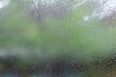 Water drops or rain droplet on the glass on blurred with backgrounds. Water drops or rain droplet on the glass on blurred with backgrounds stock photos