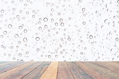 Water drops , Rain droplets on white background and empty wood desk .Blank space for text and images.  stock photography
