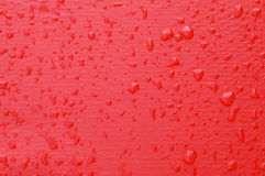 Water drops on red. Drops of rain or water on red background Royalty Free Stock Photo