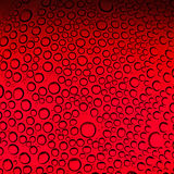 Water drops on red background Stock Photo