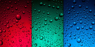 Water drops on red, green and blue Stock Photography