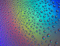 Water drops with reflection of the rainbow Stock Photography