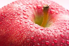 Water drops on ripe red apple Stock Photography