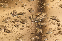 Water drops in a shiny metallic surface with table re Stock Photo