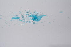 Water drops and splash. Blue water drops and splash on silver background Royalty Free Stock Photography