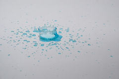 Water drops and splash. Blue water drops and splash on silver background Royalty Free Stock Images