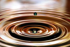 Water drops splash. Ripples and reflections on water surface.  stock photography