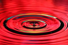 Water drops splash. Ripples and reflections on surface.  royalty free stock photography