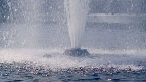 Water drops splashing on water surface in slow motion. Water fountain stock footage