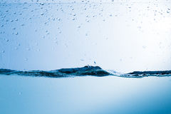 Water, drops, sprays, splashes, stream, flow, abstraction, minim Royalty Free Stock Image