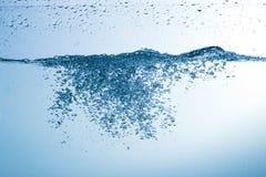 Water, drops, sprays, splashes, stream, flow, abstraction, minim Royalty Free Stock Photos