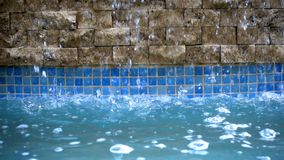 Water drops on water pool stock video footage