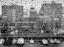 Water drops on a window in black and white. Several water drops on a window in black and white Royalty Free Stock Image