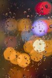 Water drops on window with color background stock photography