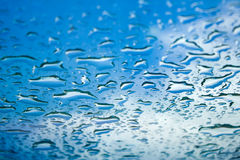 Water drops window glass blue sky perspective Royalty Free Stock Photography