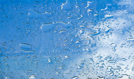 Water drops window glass blue sky Stock Photo
