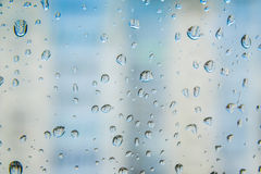 Water drops on window glass. Blue tone Royalty Free Stock Photos